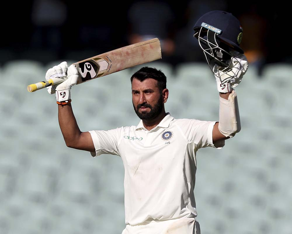 Pujara's maiden hundred in Australia bails India out of trouble