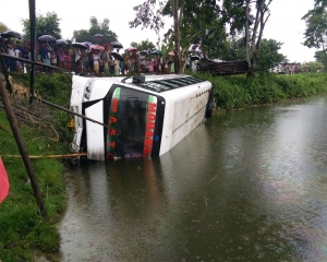 15 passengers injured as bus falls into canal