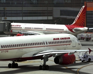 Air India crew member falls off aircraft, hospitalised