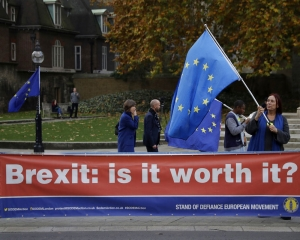 UK's May battles to save her Brexit deal and her job