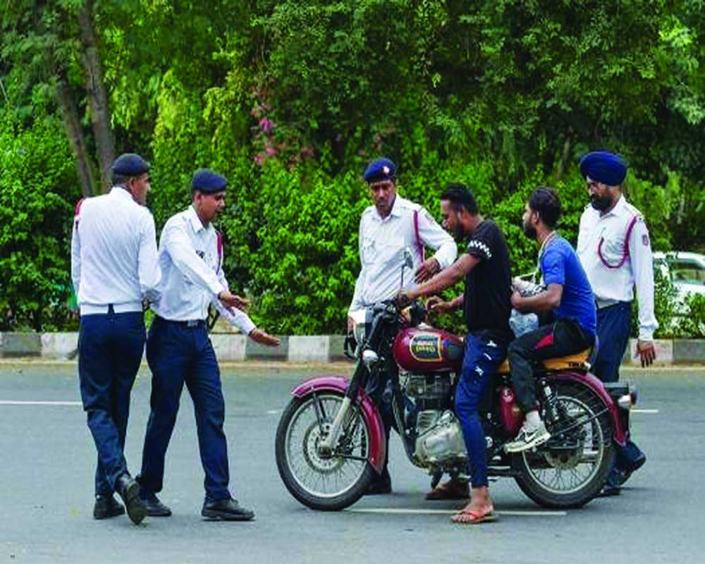 Traffic Rules helmets are mandatory even those sitting behind must wear fine if they dont wear from today - Nitidina