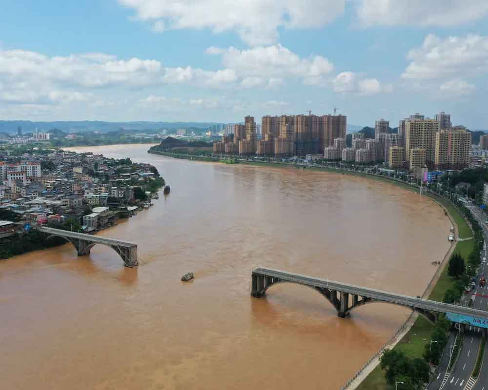 Bridge in China collapses, sending vehicles into river