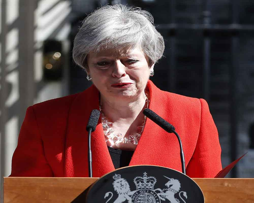 Britain's Brexit-beaten PM Theresa May announces resignation, to step down on June 7