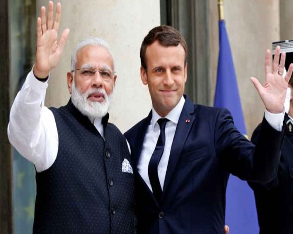 French President Macron congratulates PM Modi on poll win; pledges to work together on security