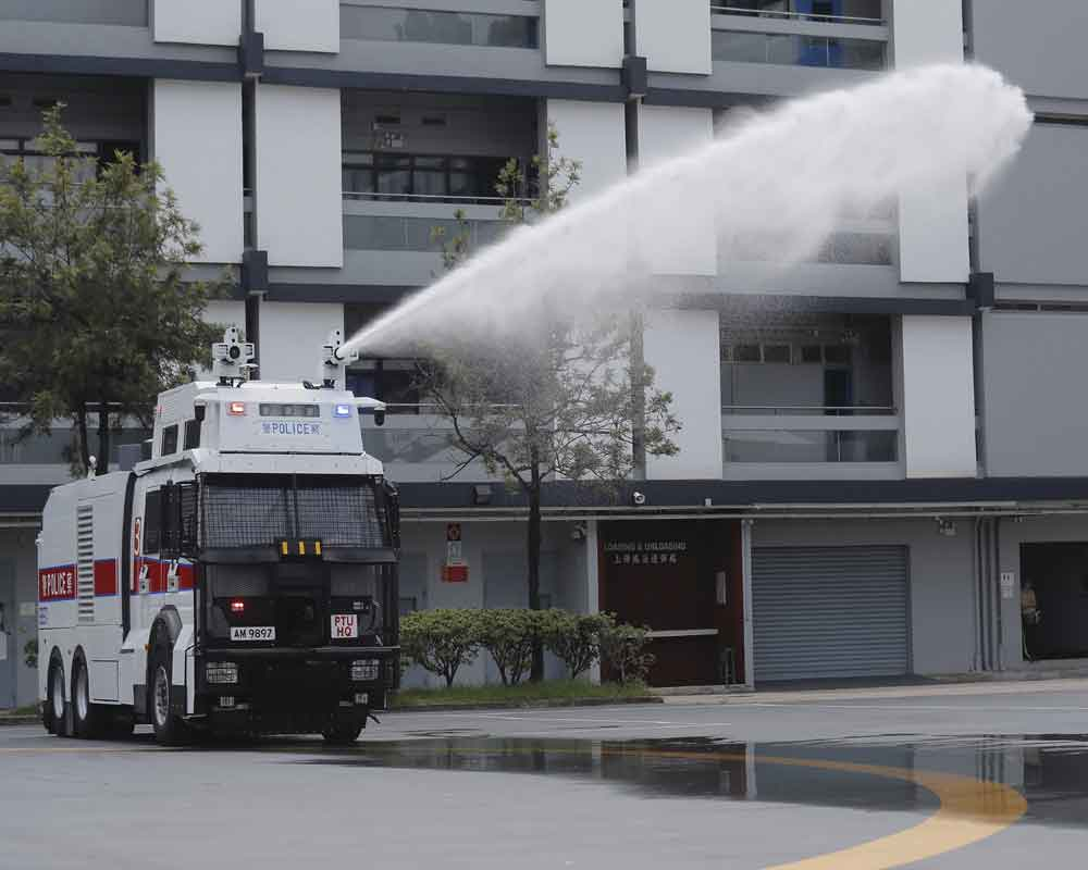 Hong Kong police demonstrate water cannon as protests linger