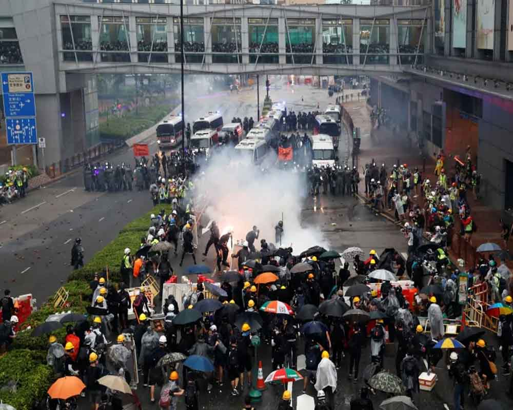 HK police say violent protesters forced use of water cannon, warning shot