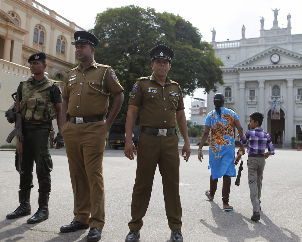 Lanka reimposes curfew as over 100 held for anti-Muslim riots