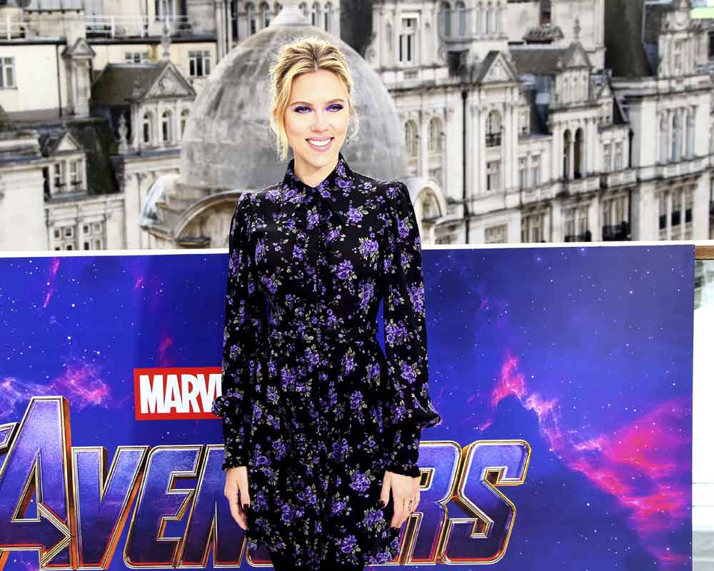 Scarlett Johansson turns heads with daring pantsuit