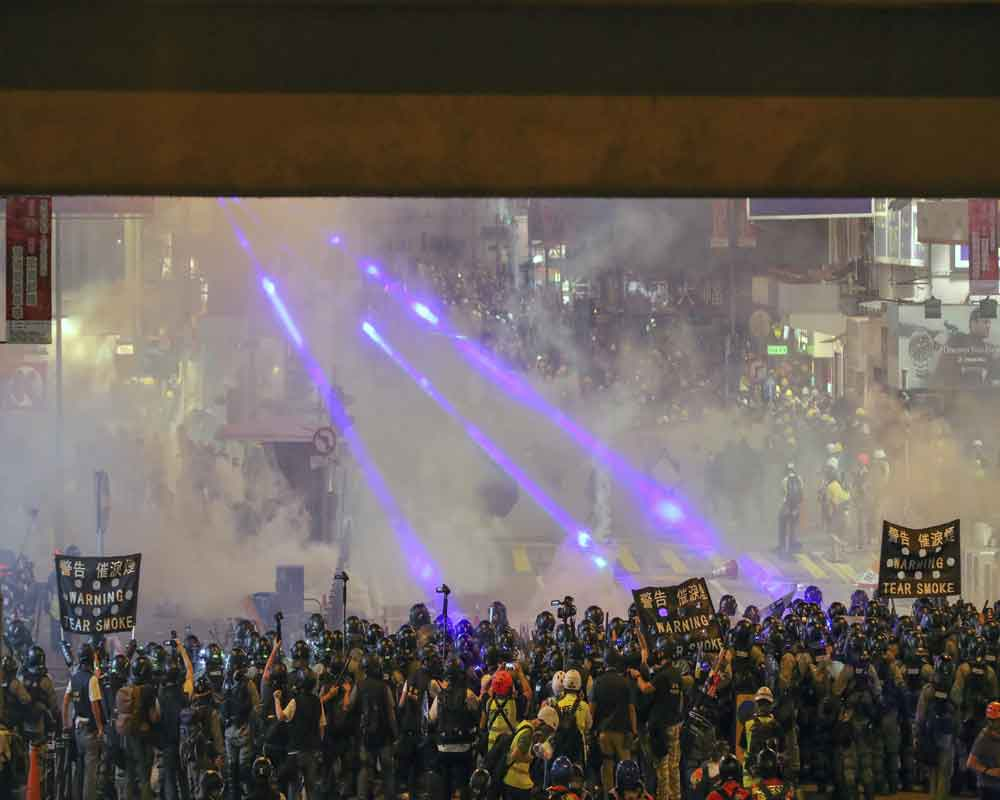 Second night of tear gas as Hong Kong protesters defy China warnings