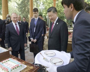 'Good gifts': Putin presents Xi with birthday ice cream