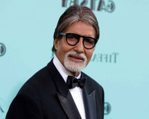 Abhishek celebrates Big B's 50 years in Bollywood