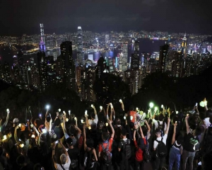 Hong Kong hills shine with protest lights in festival-themed rally