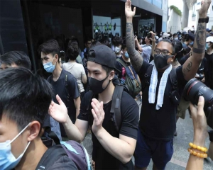 Hong Kong protesters flood city streets in 'peaceful' march