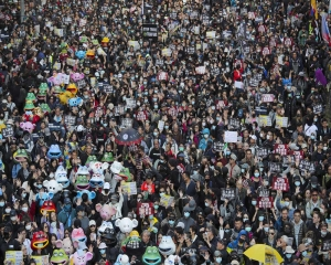 Hong Kongers mark half year protest anniversary with huge rally