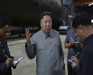 Kim inspects new submarine, wants NKorean military bolstered
