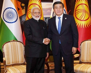 Kyrgyzstan President gifts traditional hat, coat to PM Modi