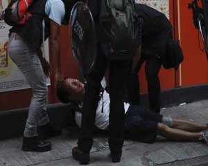 Police shoot protester in Hong Kong with live round