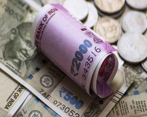 Rupee rises by 8 paise to 69.63 vs USD in early trade