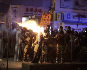 Tear gas and water cannon as crowds defy Hong Kong rally ban