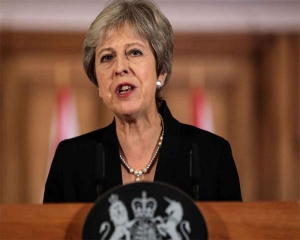 Theresa May condemns 'appalling' church attacks in Sri Lanka on Easter