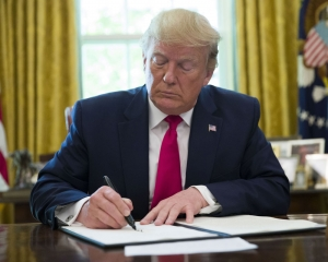 Trump signs executive order imposing 'hard hitting' sanction on Iran