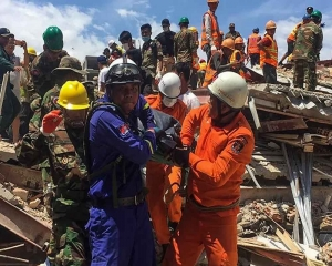 Two survivors pulled from collapsed Cambodia building