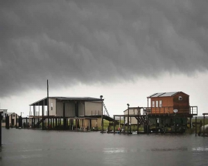 US warnings of heavy rain, tornadoes from weakening storm Barry
