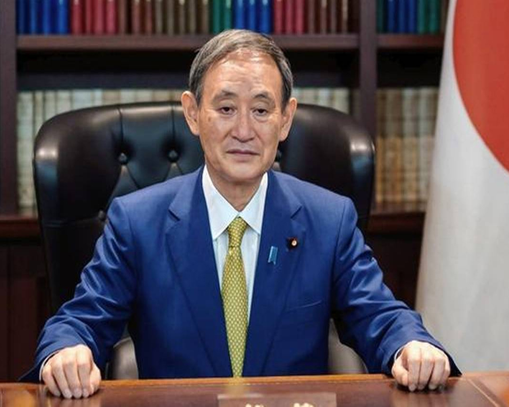 Japan's Suga holds 1st phone talks with Trump as leader