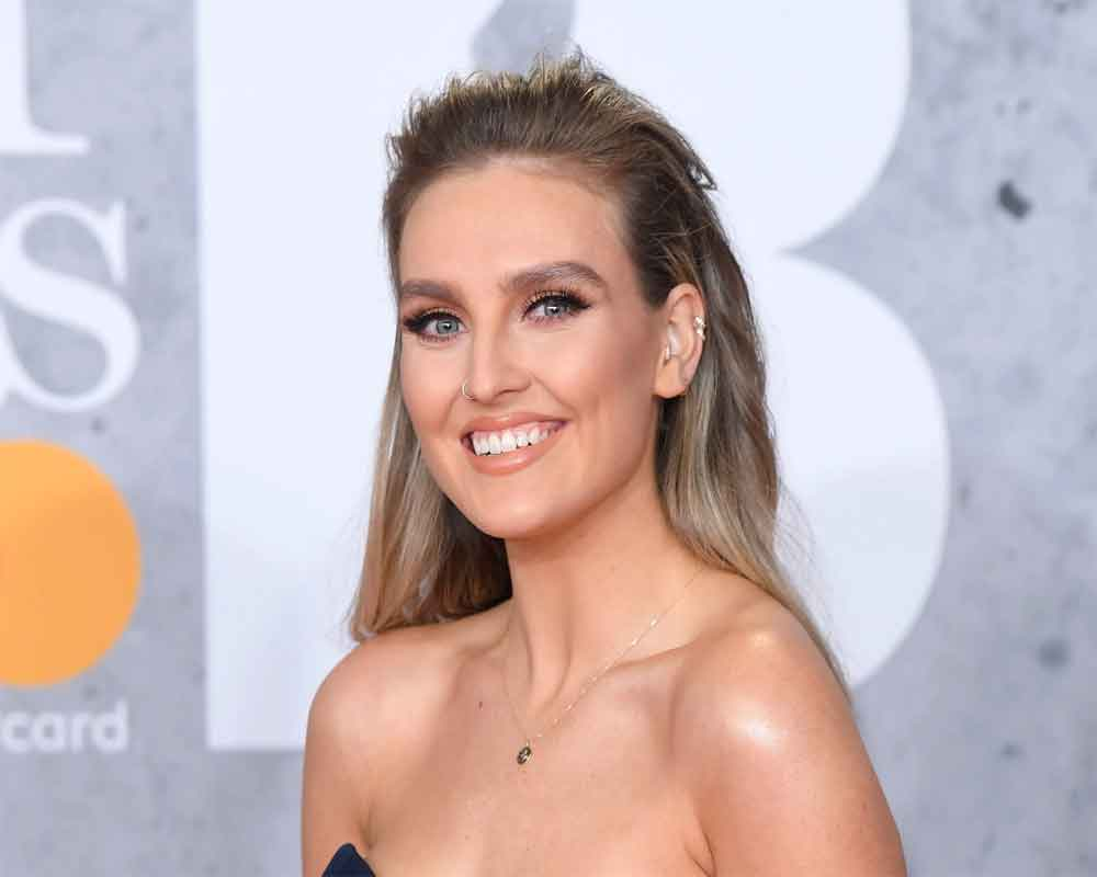 Perrie Edwards goes make-up free during outing to vets