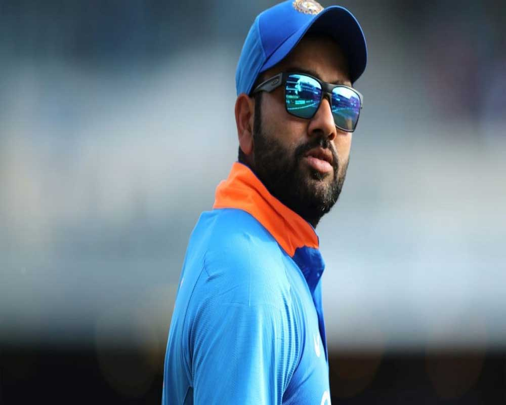 Rohit hurts his left hand, taken off the field