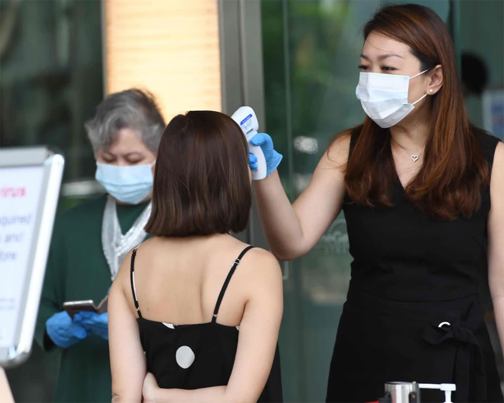 Singapore reports 642 new COVID-19 cases