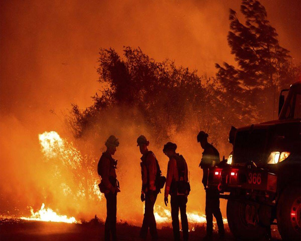 Three killed in Northern California wildfire; thousands flee