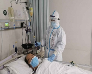 Beijing further relaxes COVID-19 curbs; Wuhan clears all patients