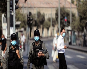 Israel tightens second lockdown as virus cases soar