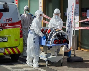 South Korea virus cases spike, as Italy and Iran take drastic steps