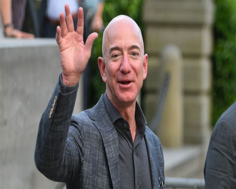 Bezos riding own rocket on company's 1st flight with people By Marcia Dunnap