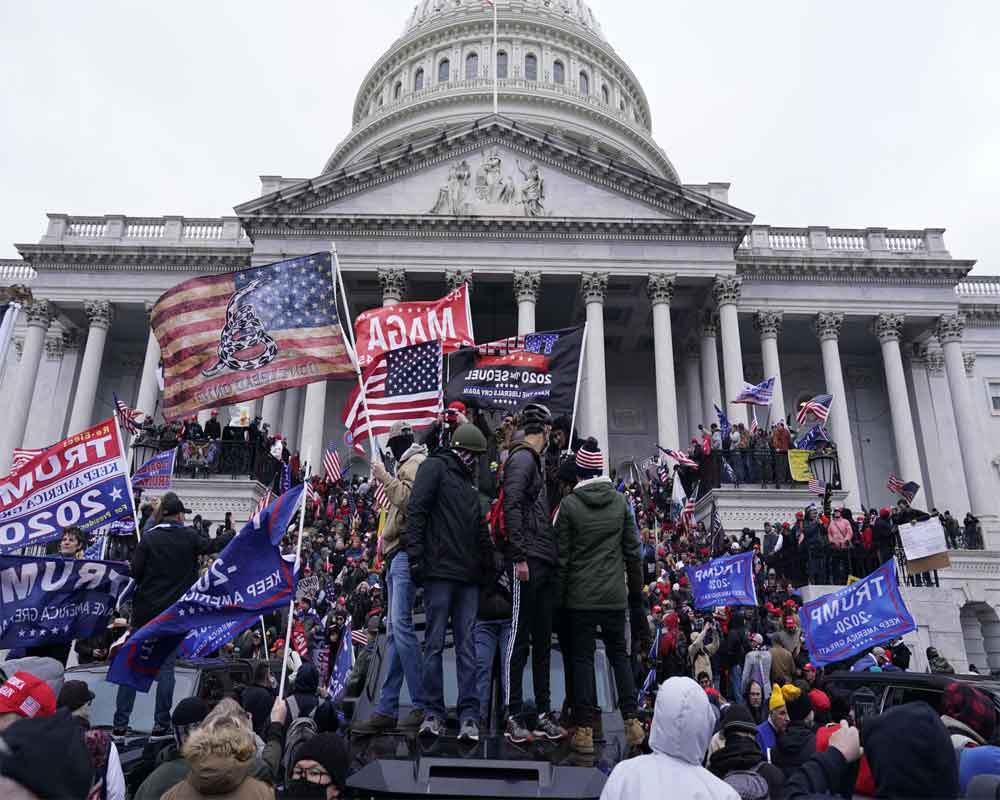 Capitol rally seeks to rewrite January 6 by exalting rioters