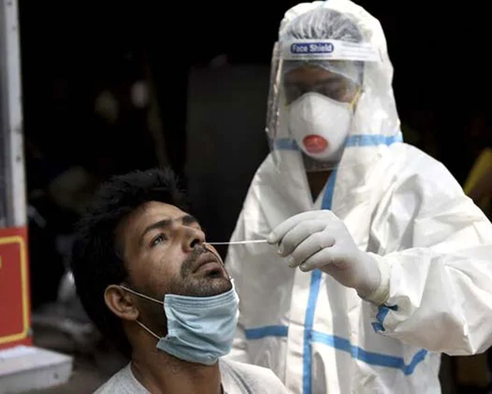 COVID-19: India records 37,566 new cases, 907 more deaths