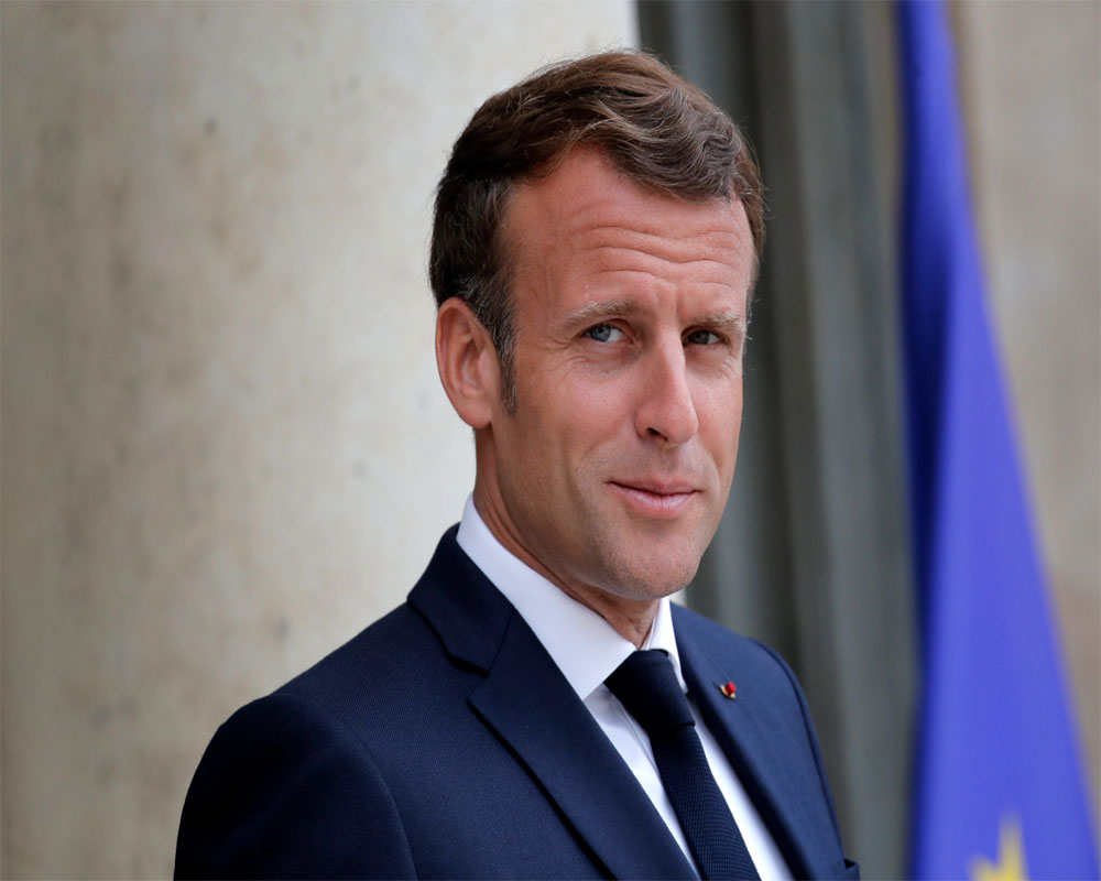 French leader Macron is slapped during visit to small town