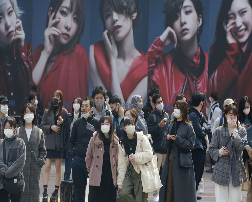 Japan to tighten border control against variants