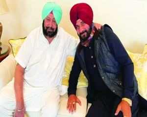 Capt relents, Sidhu set to be State Cong chief