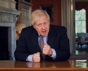 COVID-19 cases 'very clearly' going up, warns UK PM Johnson