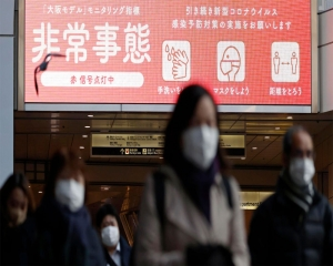 Japan widens virus emergency to 7 more areas as cases surge