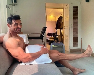 John Abraham is 'waiting for wardrobe', poses with just a pillow!