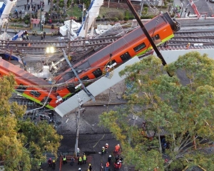 Mexico City brings charges against 10 in subway collapse