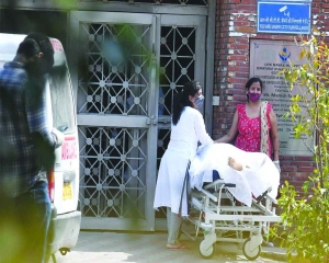 Patients die on pavements outside cramped hospitals
