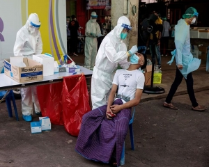 Thailand's daily COVID infections hit record, topping 1,300
