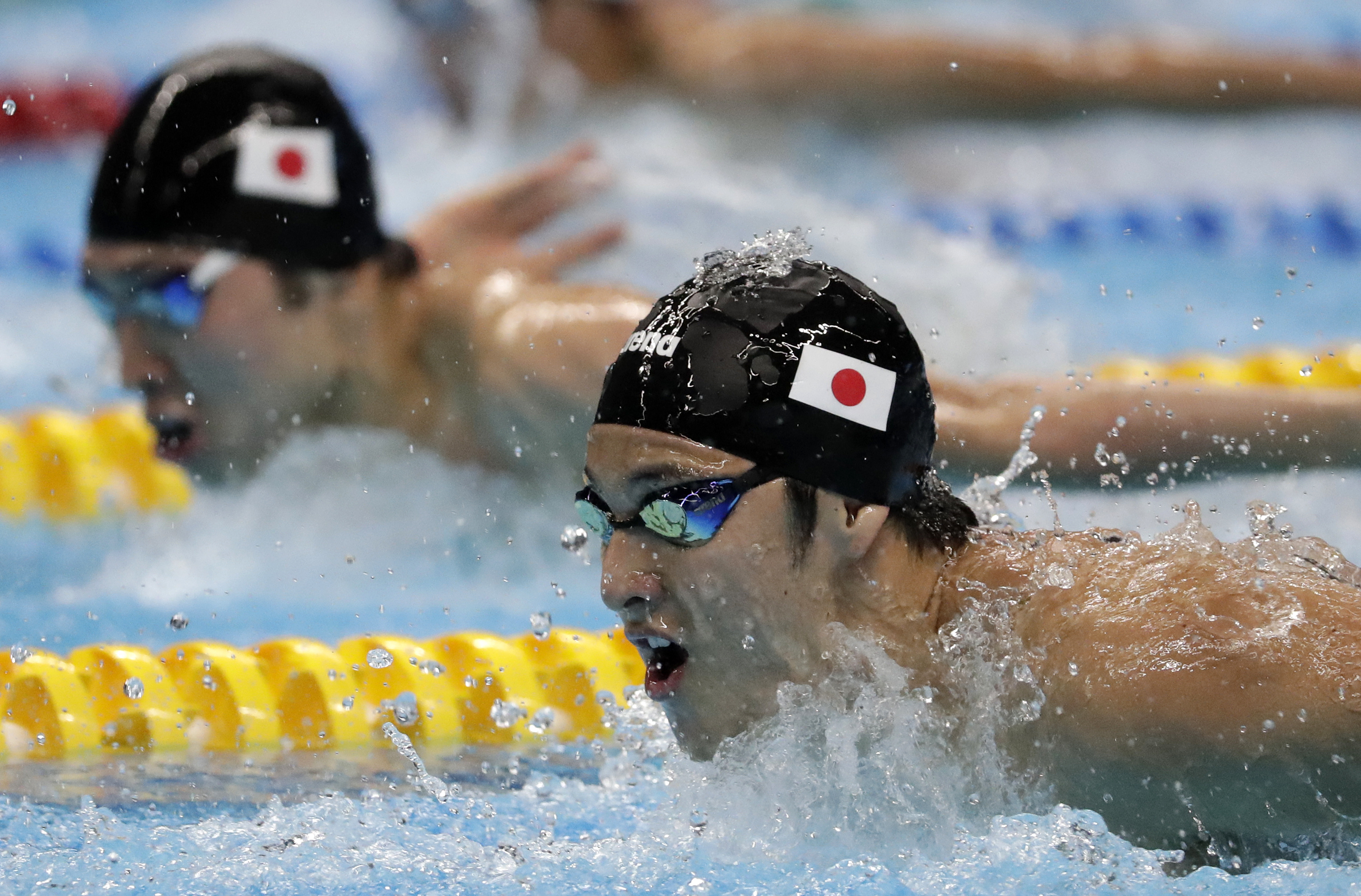 Japan`s Dalya Seto waves after winning the
