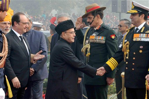 President Pranab Mukherjee and Chief Guest of theRepublic Day Celebrations Francois Hollande being received by Army Chief Gen Dalbir Singh Suhag, Navy Chief RK Dhowan on their arrival at the 67th Republic Dayparade at Rajpath in New Delhi. AP