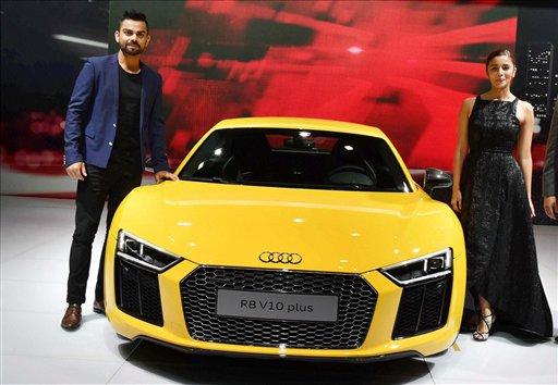 Cricketer Virat Kohli and actress Alia Bhatt at the launch of Audi's new sports car R8 V10 plus at Auto Expo 2016 in Greater Noida. PTI